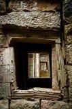 View through stone window. At temples Angkor Wat Stock Photos