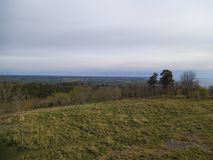 View from a stoney hill over a nature park in Sweden stock photo