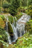 View of stony waterfall and small river Stock Photography