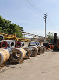 View of the storage of steel coils with loader Royalty Free Stock Photography