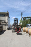 View of the storage of steel coils with loader Royalty Free Stock Photos