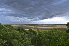 The view of Storm clouds from the ruins of Troy. Across the plain of Ilium to the Aegean Sea stock photography