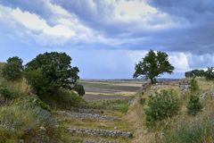 The view of Storm clouds from the ruins of Troy. Across the plain of Ilium to the Aegean Sea royalty free stock image