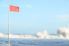 View of Storm Seascape and Red Flag Stock Image