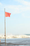 View of Storm Seascape and Red Flag Royalty Free Stock Images