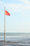 View of Storm Seascape and Red Flag Royalty Free Stock Image
