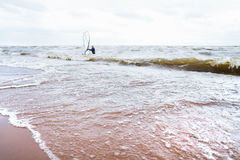 View of storm seascape. Windsurf board. Water sport stock photo