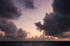 View of a stormy sky at sunset over the sea. royalty free stock photos