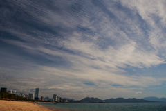 view of strange fleecy and stratus clouds above sea beach Stock Photo