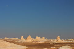 View of strange rock shapes due to erosion in White Desert close to Farafra oasis in Egypt. Stock Photography