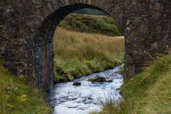 A view through the fairy bridge on the Isle of Skye stock image