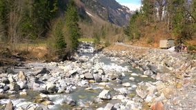 View of the stream in late winter sunny day stock footage
