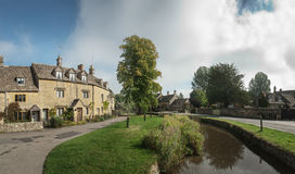 View of stream through a street in the Cotswold, England Stock Image
