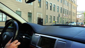 View of the street from the cabin of a moving car business class stock footage