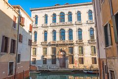 View of the street canal in Venice, colorful facades of old houses.  royalty free stock photos