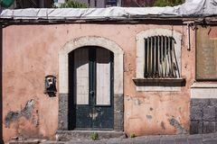 View on street of Catania, Sicily, Italy - facade of an ancient building royalty free stock photo