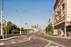 View of a street in the centre of Moscow with skyscrapers of the Moscow City International Business Centre in the background stock images