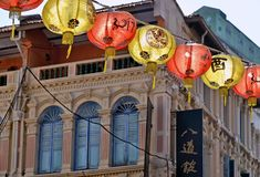 A view of a street in Chinatown district with colorful old buildings and red and yellows lanterns decorations. royalty free stock images
