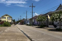 View of a street with colorful houses in the Marigny neighborhood in the city of New Orleans, Louisiana. New Orleans, Louisiana - June 17, 2014: View of a street Stock Image