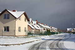 View on street with cottages in winter Royalty Free Stock Photo