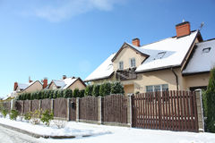 View on street with cottages in winter Royalty Free Stock Image