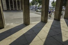 View of a street in Dusseldorf, Germany from an old building with shadows cast by the pillars on a sunny day. View of a street in Dusseldorf, Germany from an stock photo