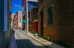 View of street and historical buildings in the North End neighborhood of Boston. Boston, USA: May 20, 2017: View of street and historical buildings in the North royalty free stock photography