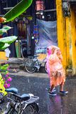 View of the street in Hoi An old town, Vietnam in rain day Royalty Free Stock Photography