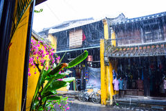 View of the street in Hoi An old town, Vietnam in rain day Royalty Free Stock Photos