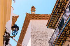 View of the street lamp and spanish tiles at the bottom of balconies in the historic center of Sitges, Barcelona, Catalunya, Spain Stock Photo