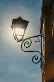 View of street lamp with sunlight and clear blue sky in Paraty. Stock Photography