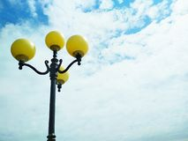 Street light, architectural decision. View of a street light against the background of the sky covered with clouds royalty free stock images