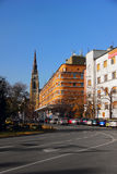 View on a street in Novi Sad with a cathedral in the background Royalty Free Stock Photography