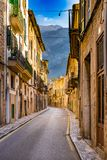Spain Majorca, street with mediterranena old houses and mountain landscape in Soller village. View of an street in Soller, town in Serra de Tramuntana mountains royalty free stock images