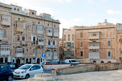 View on the street St Elmo Place and traditional Maltese homes. Valletta , Malta -24.12.2014  Valletta , Malta, View on the street St Elmo Place and traditional Royalty Free Stock Photo