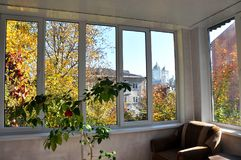 View of the street from the verandas with metal-plastic windows. View of the street and autumn landscape from the verandas with metal-plastic windows Royalty Free Stock Photos