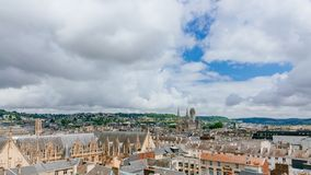 View of the streets and architecture in the historical city center of Rouen, France, with Saint-Ouen Abbey Church in the distance. Panoramic view of the streets royalty free stock image
