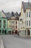 View on streets and houses at city of Alesund Stock Photos