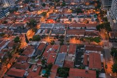 View of the streets lights and house roofs in the early morning lights, at the city of São Paulo. Stock Photography