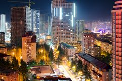 View of the streets of the night city of Batumi with skyscrapers, light from windows of apartment buildings, traffic cars Royalty Free Stock Image