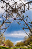View of the structure under power transmission tower. Upward view of the structure under power transmission tower stock images