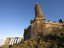 A view of structures on Calton Hill, Edinburgh, Scotland. A view of the Nelson Monument and National Monument of Scotland on Calton Hill, Edinburgh, Scotland Royalty Free Stock Photo