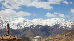 View of stupa in the valley of Lah with the snow mountain in the background. Ladakh, India stock footage
