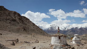 View of stupas and snow mountain stock video