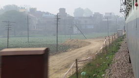 View on suburban landscape in Jodhpur from a moving train. JODHPUR, INDIA - 13 FEBRUARY 2015: View on suburban landscape in Jodhpur from a moving train stock footage