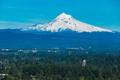 View of suburbs and snowy Mt Hood east of Portland, Oregon. Snowy Mount Hood and suburbs to the east of Portland, Oregon Royalty Free Stock Photography