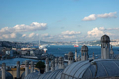 View from The Suleymaniye Mosque over The Istanbul. Some historical domes and chimneys are visible at the image. Also famous Galata Bridge, Bopshorus Bridge Stock Images