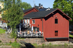 A view of summer cafe on the river bank of Porvoyoki in the old city Porvoo Stock Photography