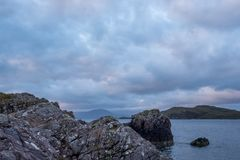 View of the Summer Isles, taken from the mainland with rocks in foreground, taken north of Polbain on the west coast of Scotland. Wide angle view of the mainly royalty free stock images
