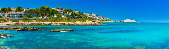 View of summer Spain in sunny weather. Panoramic seascape of Mediterranean sea,and seaside resort in high summer royalty free stock photography